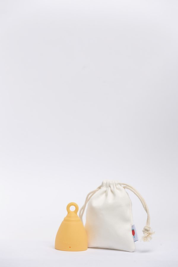 Cocmau Menstrual Cup in Sunshine Yellow with storage bag made of organic cotton